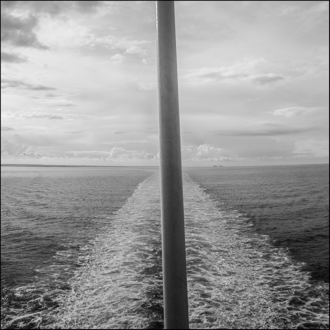 black and white photograph of a flagpole on a ferry