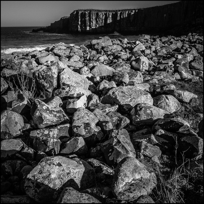 Northumberland Beach black and white photograph rocks sea and cliffs